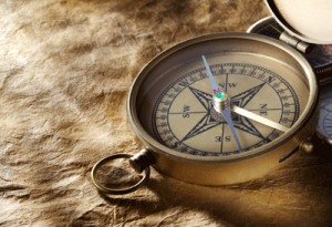 bigstock-Vintage-compass-on-paper-backg-54136208
